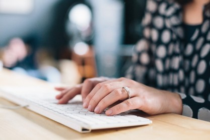 Social-media-manager-hire-woman-keyboard-768x512